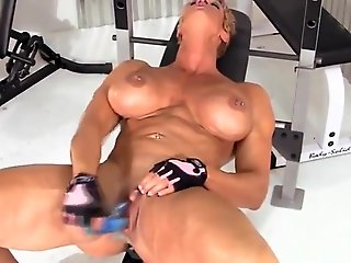 mature, big clit, old muscle woman masturbates her big clit