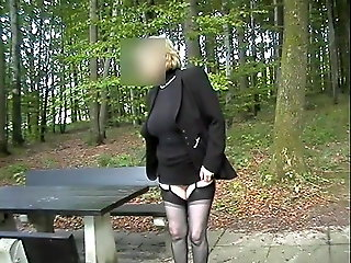 public nudity, mature, Gisela secretary on the motorway service compass